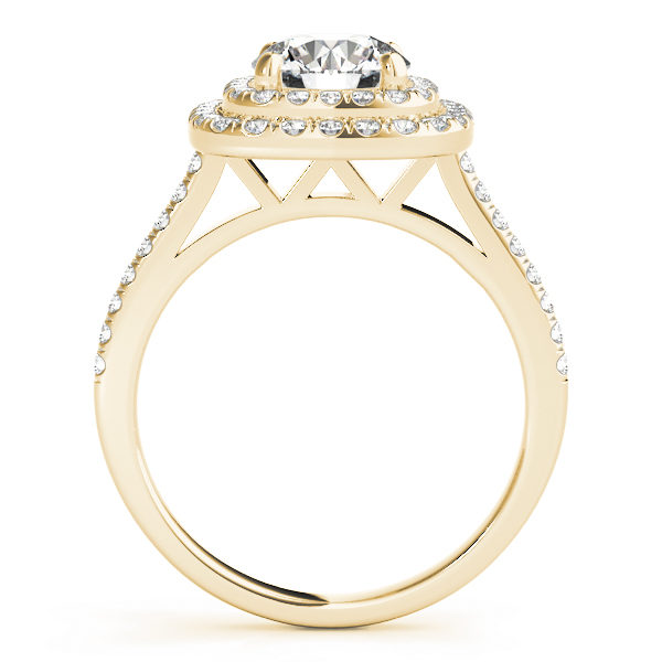 The side view of a yellow gold double halo engagement ring with a double V-shaped under gallery, seta against a white backdrop.