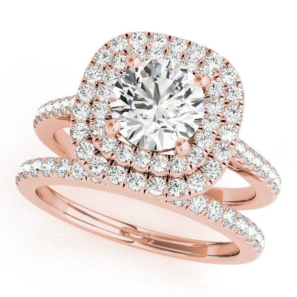 A wedding ring set made of rose gold set; which consists of a double halo diamond engagement ring and a diamond studded wedding band, set against a white backdrop.