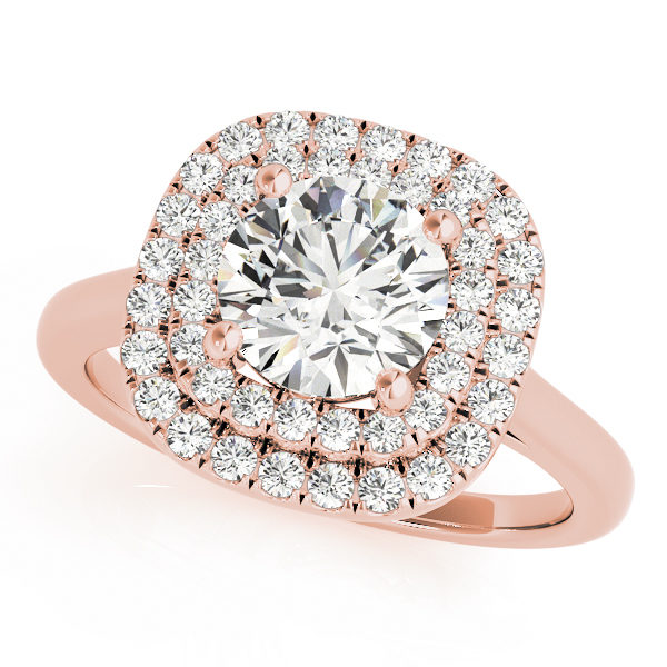 A double halo engagement ring with a large diamond centre piece set on a plain rose gold band placed against a white backdrop