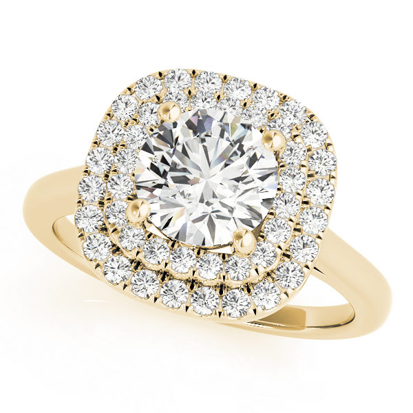 A double halo engagement ring with a large diamond centre piece set on a plain yellow gold band placed against a white backdrop