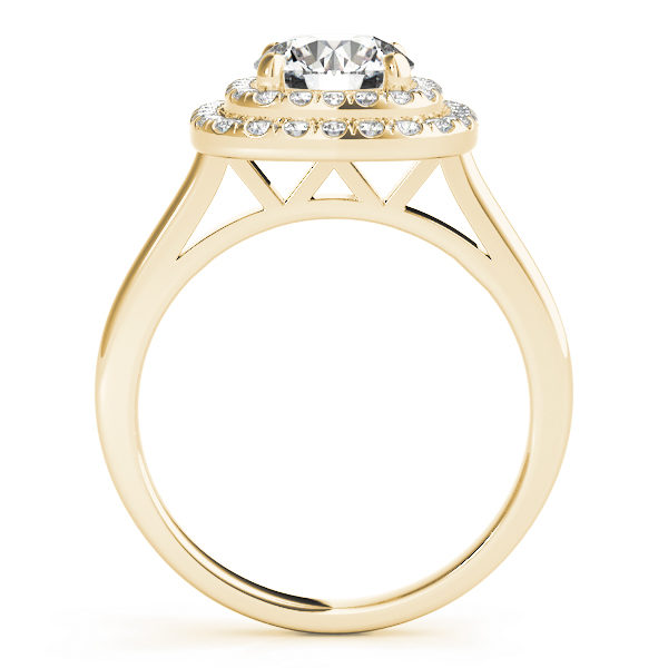 Sideview of a yellow gold cathedral ring with double halo and a diamond at the center of a 4-pronged ring setting