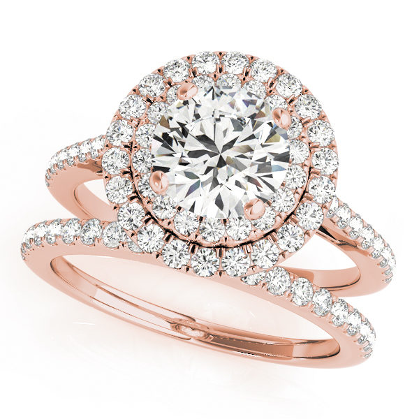 Top view of double halo engagement ring and wedding band in rose gold