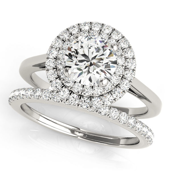 Wedding set of a double halo round engagement ring and a wedding diamond band in white gold