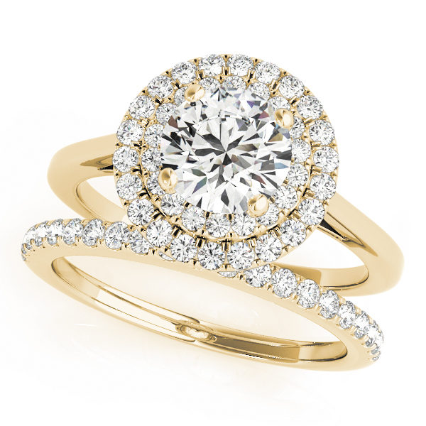 Wedding set of a double halo round engagement ring and a wedding diamond band in yellow gold