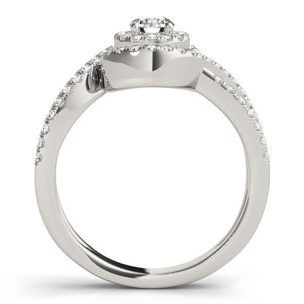 Side view of a white gold ring band with pave halo design and a diamond at the center