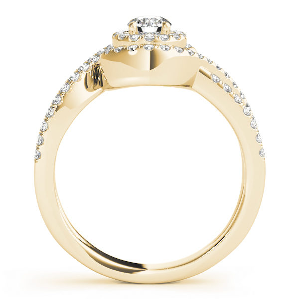 Side view of a yellow gold ring band with pave halo design and a diamond at the center