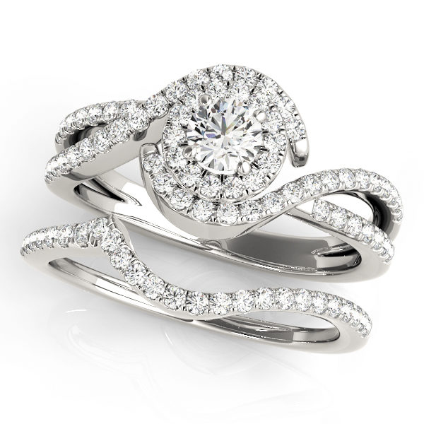 Twisted, double band halo diamond ring made from white gold with a round cut diamond at the center.