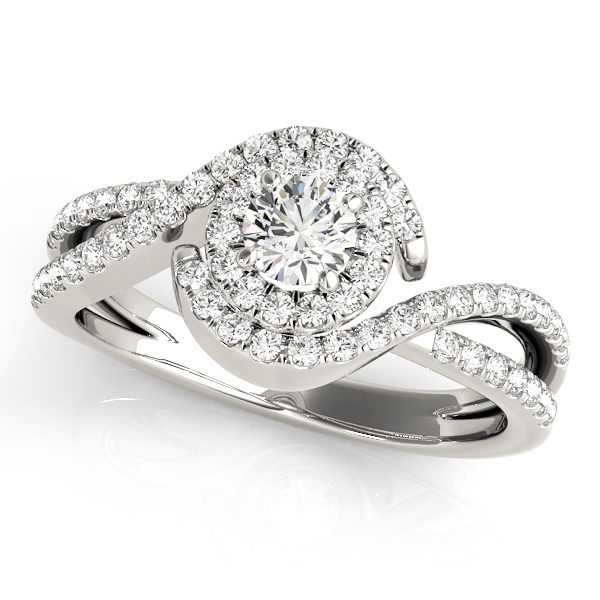 Twisted white gold ring band with pave halo and a round-cut diamond on a 4-pronged ring setting