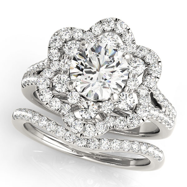 top view of a flower halo diamond engagement ring and a wedding band in white gold