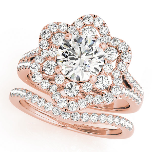 top view of a flower halo diamond engagement ring and a wedding band in rose gold