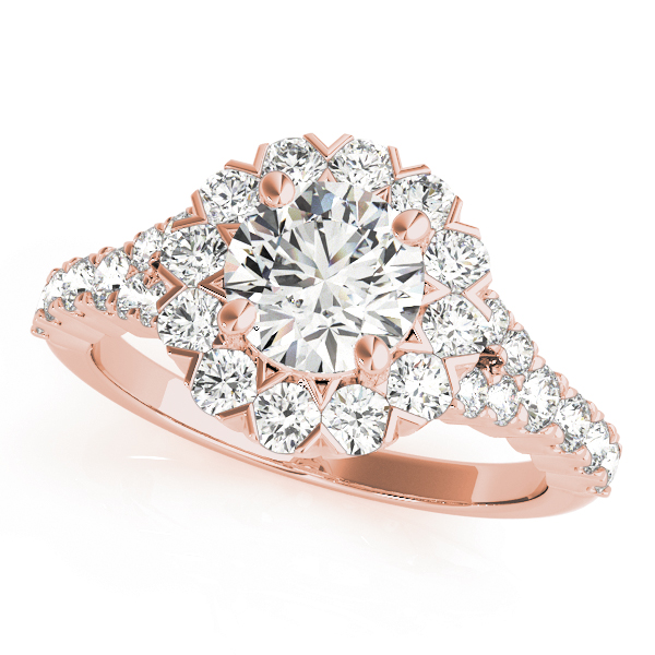 Rose gold round cut engagement ring in a halo setting with set of diamonds on upper shank