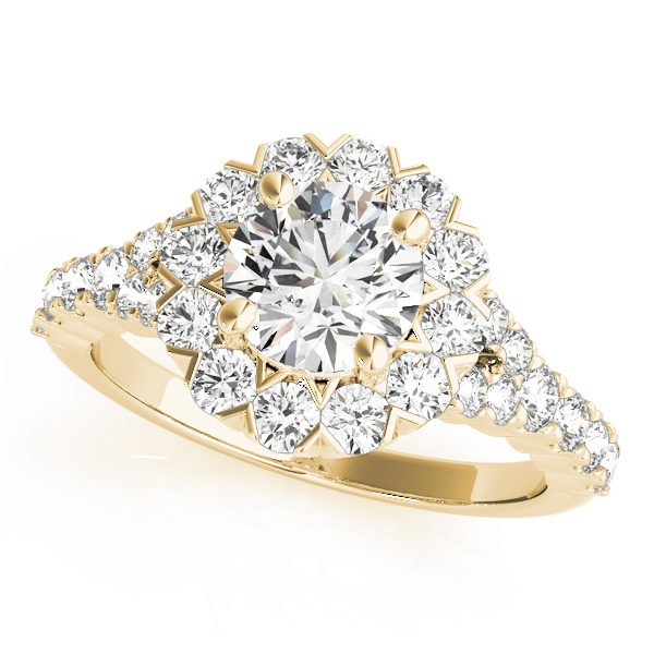 Yellow gold round cut engagement ring in a halo setting with set of diamonds on upper shank