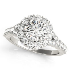 White gold round cut engagement ring in a halo setting with set of diamonds on upper shank