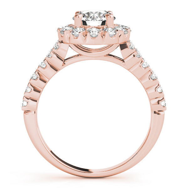 Front view of round cut engagement ring showing the side of the ring in rose gold