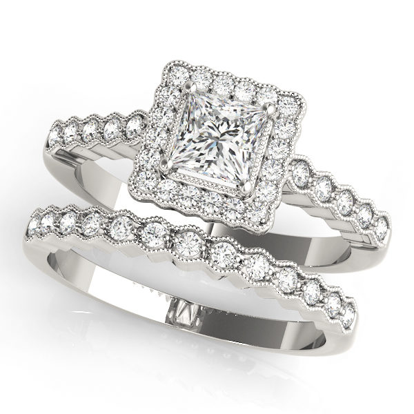 Double band white gold ring with pave halo design and a princess cut diamond in a 4-pronged setting