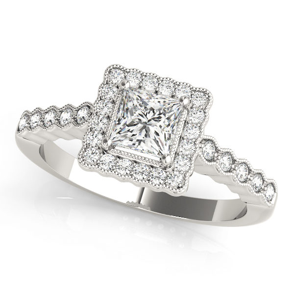 White gold ring band with pave halo design and a princess cut diamond in a 4-pronged setting at the center