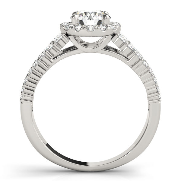 White gold halo engagement ring in upright position with pave set diamonds on it