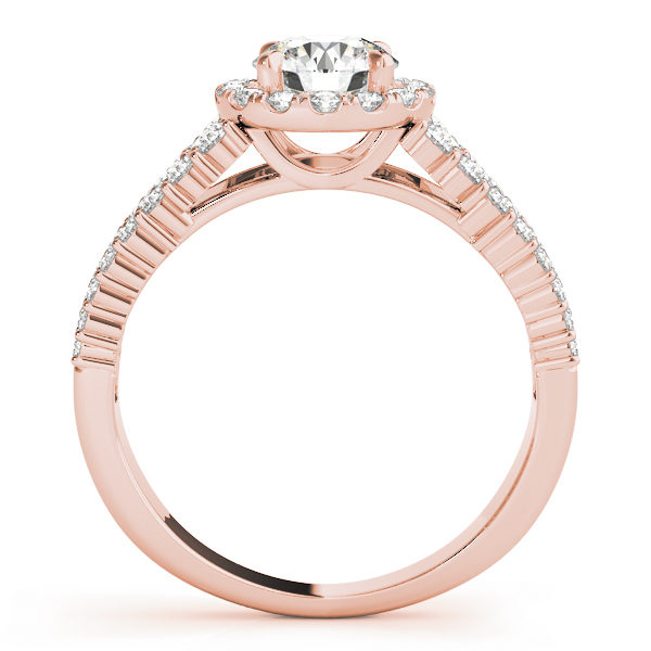 Rose gold halo engagement ring in upright position with pave set diamonds on it