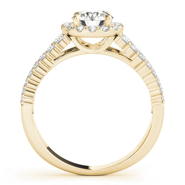 Yellow gold halo engagement ring in upright position with pave set diamonds on it