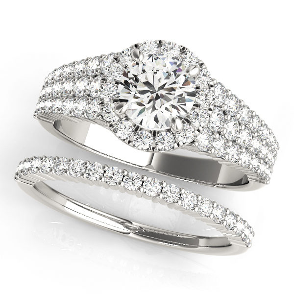 Pave set wedding white gold ring set consisting of diamond halo engagement ring and a diamond studded wedding band