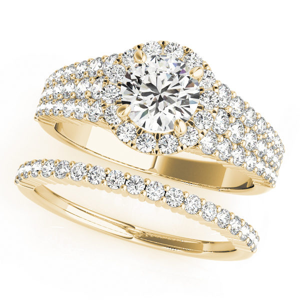 Yellow gold double band with halo melee diamonds and a large round cut diamond in a 4-pronged setting at the center
