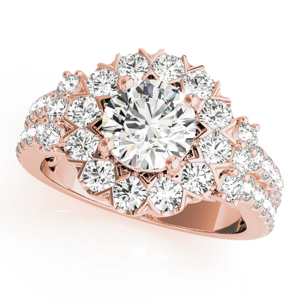 top view of large halo diamond ring in a two row band in rose gold