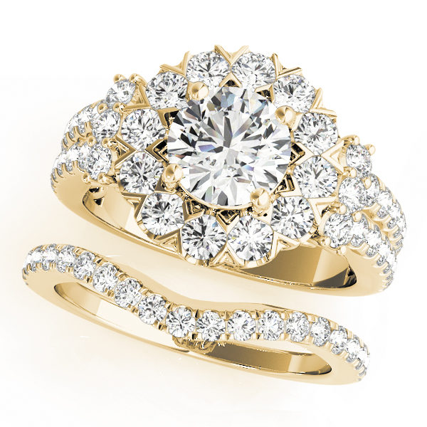 top view of large halo diamond ring in a two row band and a wedding band in yellow gold