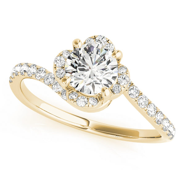 top view of a yellow gold floral inspired bypass halo engagement ring