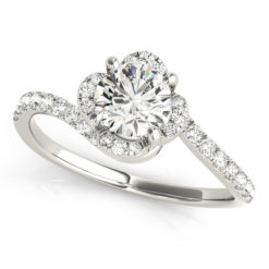 top view of a white gold floral inspired bypass halo engagement ring