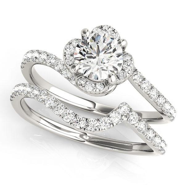 wedding set of a white gold diamond twist shank engagement ring with white gold wedding band
