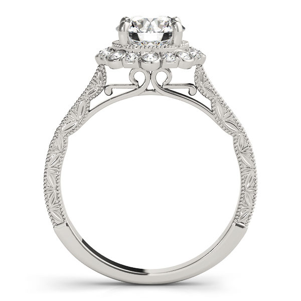 front view of a white gold diamond round halo engagement ring with leaf designs on the shank