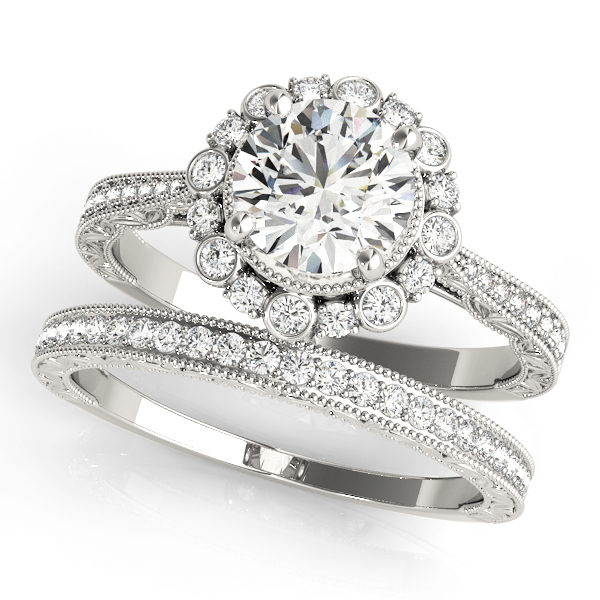 top view of a white gold diamond round halo engagement ring and a band with diamond accents