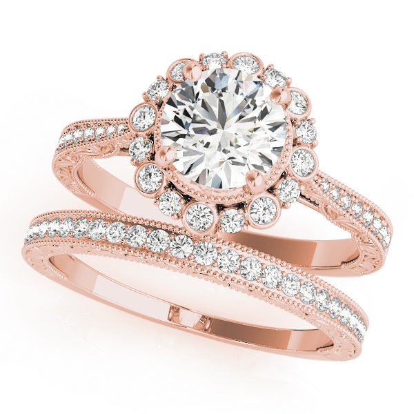 top view of a rose gold diamond round halo engagement ring and a band with diamond accents
