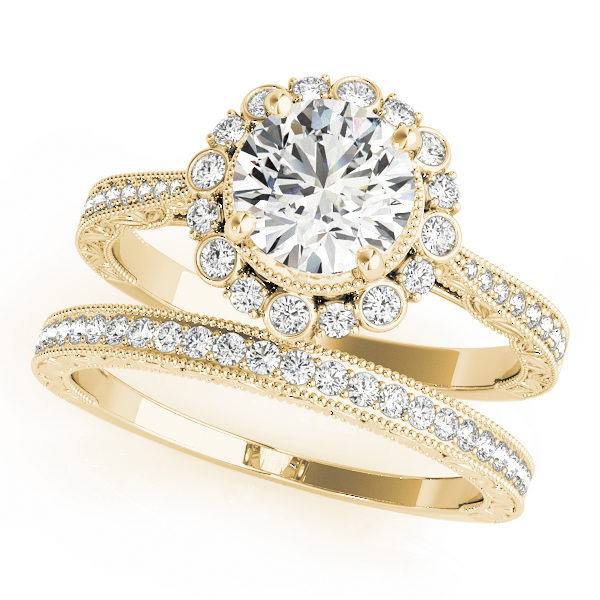 top view of a yellow gold diamond round halo engagement ring and a band with diamond accents