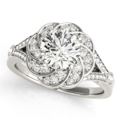 Top view of a white gold diamond flower ring designed with floral swirl in a split shank band