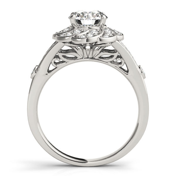 Front view of diamond flower ring revealing the gallery part of the ring formed with leaves in white gold band