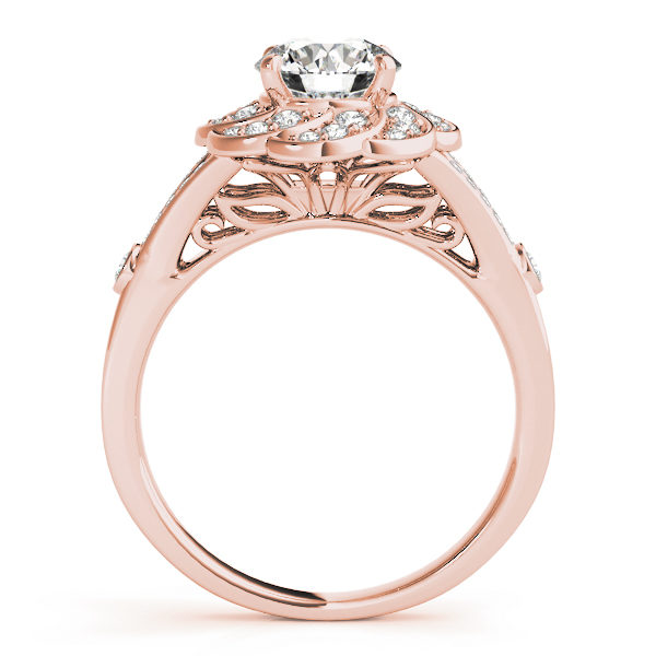 Front view of diamond flower ring revealing the gallery part of the ring formed with leaves in rose gold band