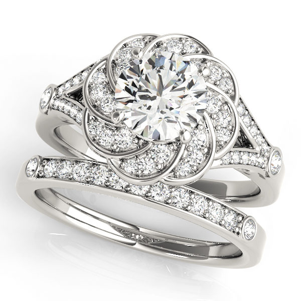 Wedding set of a white gold diamond flower ring in split shank and a wedding band embedded with row of diamonds in upper shank