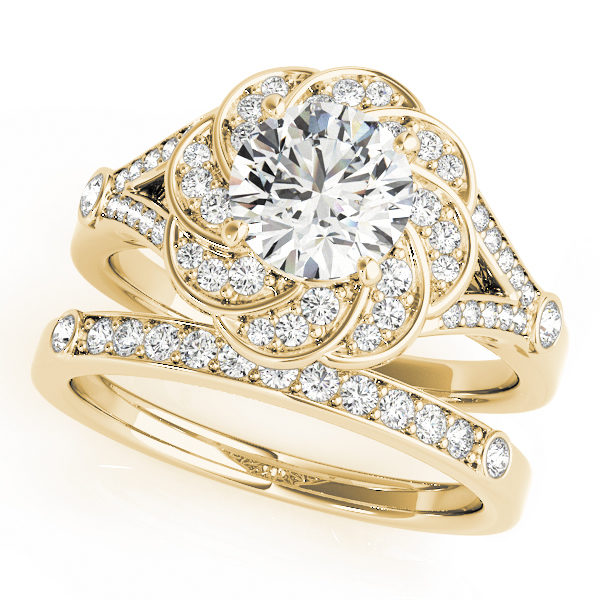 Wedding set of a yellow gold diamond flower ring in split shank and a wedding band embedded with row of diamonds in upper shank