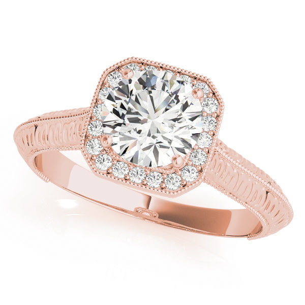 Rose gold halo engagement ring with a diamond center stone with an intricate design on band