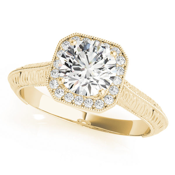 Yellow gold halo engagement ring with a diamond center stone with an intricate design on band