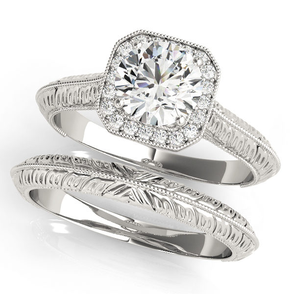 Two silver halo engagement rings with a diamond center stone on one ring and intricate designs on each band
