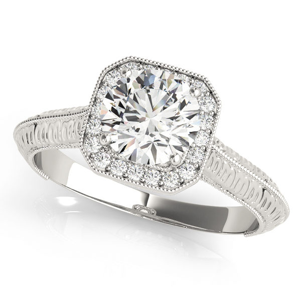 White gold clean diamond ring with halo with a diamond center stone with an intricate design on band