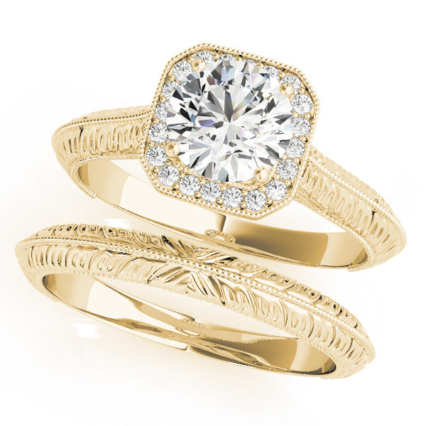 Two white gold halo engagement rings with a diamond center stone on one ring and intricate designs on each band