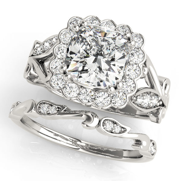 top view of a large white gold cathedral square halo diamond engagement ring and a freeform band ring with no head