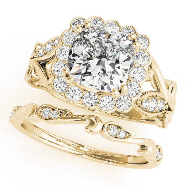 top view of a large yellow gold cathedral square halo diamond engagement ring and a freeform band ring with no head
