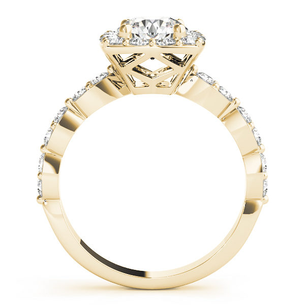 front view of a large yellow gold cathedral diamond engagement ring with a number of side and accent stones