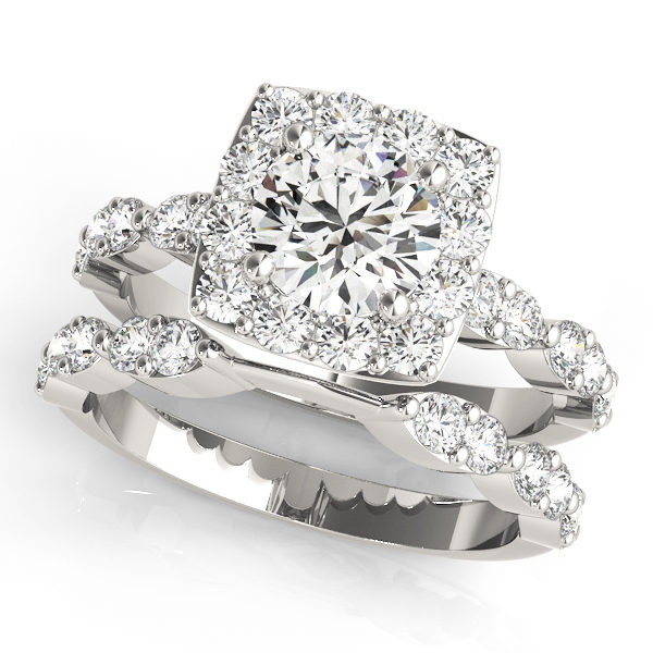top view of a large white gold cathedral diamond engagement ring and a plain one with a number of side and accent stones