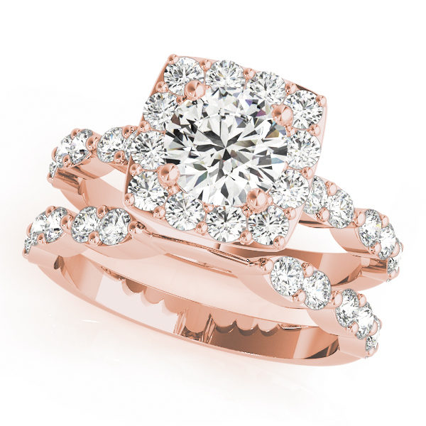 top view of a large rose gold cathedral diamond engagement ring and a plain one with a number of side and accent stones