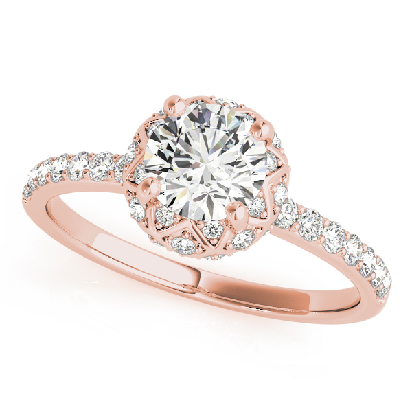 top view of a rose gold diamond star-like halo engagement ring with a number of side and accent stones